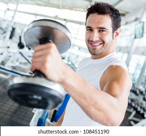 Strong man at the gym lifting weights