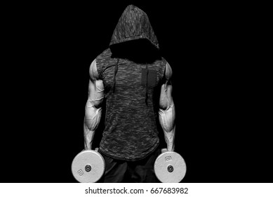 Strong man holding dumbbells