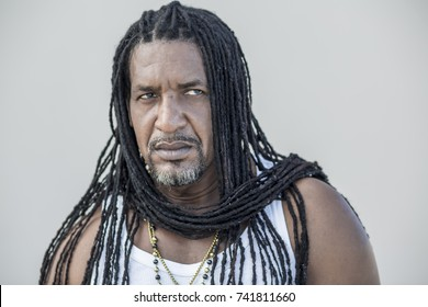 strong man with long dreadlocks, that wrapped as a scarf