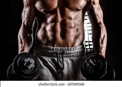 Strong Man Male Bodybuilder in Action with weights