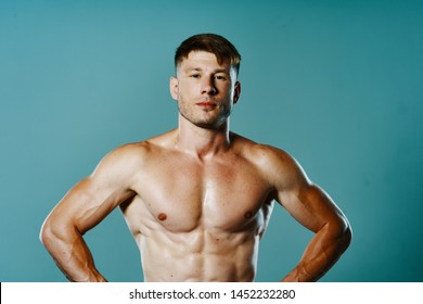 strong man with a naked torso on a blue background