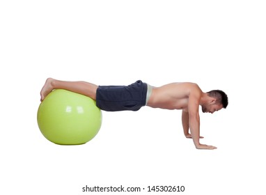 Strong man practicing push-ups with a big ball isolated on a white background