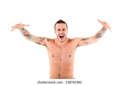 strong man  shouting and roaring with tattoos