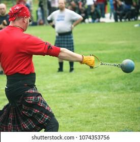 Strong Man Throwing Weight at Scottish Highland Games