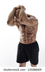 Strong, masculine, muscular man/Muscular man with dumbbells on white background