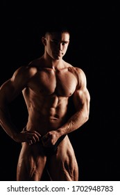 Strong men posing and showing muscles. Great shape before championship. Perfect for sport nutrition promo. Athlete and bodybuilder. Close-ups. Black background.