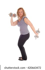 A strong middle age woman in black pants and striped top working out
