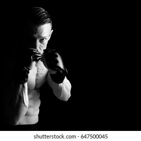 Strong Mixed Martial Arts fighter isolated in black