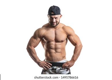 Strong and Muscular Athletic Man, Fitness Model Torso showing six pack abs isolated on white background.