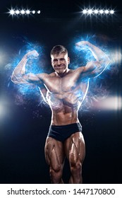 Strong muscular bodybuilder athlete man posing and pumping up muscles on black background. Workout bodybuilding concept.