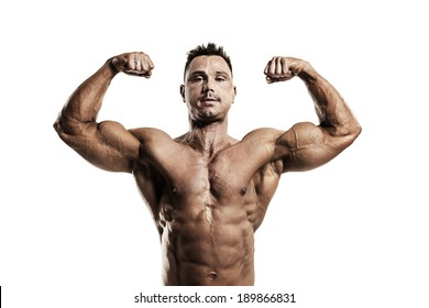 Strong muscular man showing biceps on white background