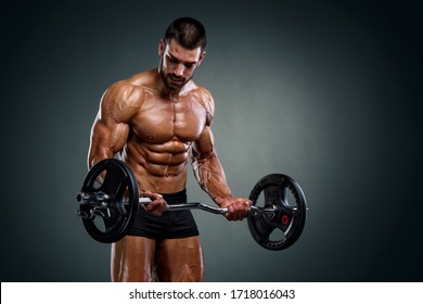 Strong Muscular Men Lifting Weights. Bodybuilder Doing Bicep Curls Exercise