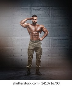 Strong Muscular Soldier Standing Tall. Military Fitness