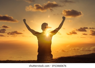 Strong powerful man flexing his arms up to the sky. Mental and physical strength concept.