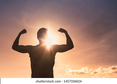 Strong powerful man flexing. People feeling determined, and winning.
