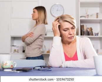 Strong quarrel between elderly mother and her adult daughter