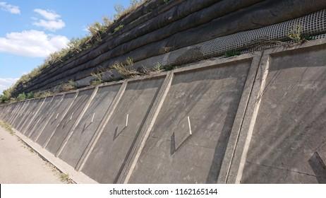 strong reinforced concrete walls protecting against seasonal landslides