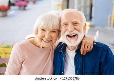 Strong relationships. Gay senior couple making laugh and looking at camera