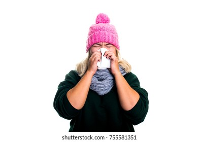 Strong rhinitis. Stuffy nose, cold, flu, temperature. Young woman is sick, blows her nose isolated on white background. A modern concept of health, self-care, treatment.