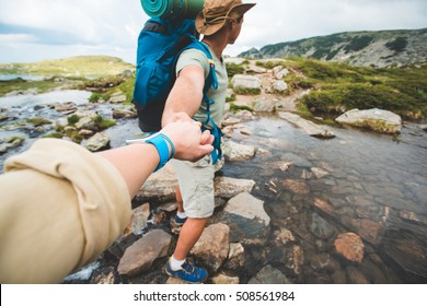 strong and romantic traveler guiding woman to the mountain