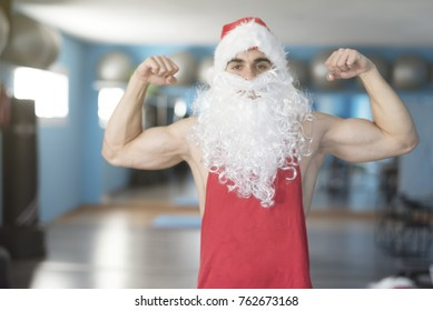 Strong Santa Claus posing in gym after Christmas holidays without any fat in his body