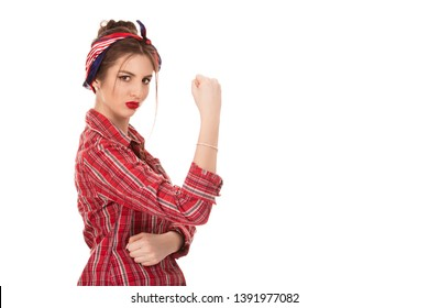 Strong and self-confident woman with a clenched fist rolling up her sleeve, icon of the american women's lib movement Rosie Riveter, isolated on white, copy space