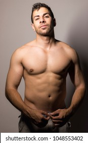 Strong shirtless man posing in night portrait