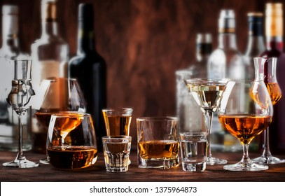 Strong Spirits Set. Hard alcoholic drinks in glasses in assortment: vodka, cognac, tequila, brandy and whiskey, grappa, liqueur, vermouth, tincture, rum.