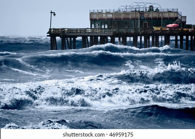 Strong storm driven waves pound the wharf