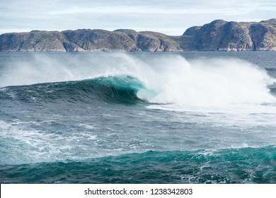 Strong and stromy blue waves on the coast of the Arctic Ocean in Teriberka, Kola Peninsula - Shutterstock ID 1238342803