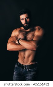 Strong stylish successful man in a white shirt. Men's look. Color brutal man portrait. Brutal man with a sporty and inflated body. Strong athletic guy with bare chest.