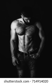 Strong stylish successful man in a white shirt. Men's look. Color brutal man portrait. Brutal man with a sporty and inflated body. Strong athletic guy with bare chest. Black and white photo.