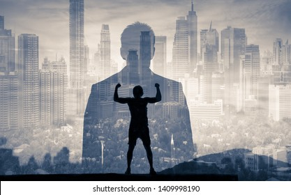 Strong, successful, determined businessman looking at the city.