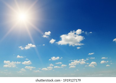 Strong sun, blue sky and cumulus clouds. - Shutterstock ID 1919127179