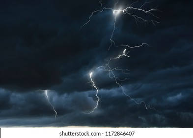 Strong thunder storm in black clouds