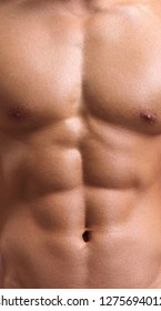 strong torso of a young man close up