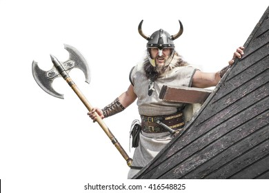 Strong Viking on his ship. Angry man holding historical axe weapon on ship looking at camera. isolated on white background.