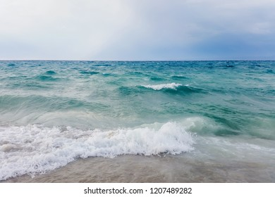 Strong waves crash over the beach Beautiful seascape.