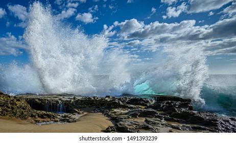 Strong waves crashing into the tide pools at Kaena Point, Oahu, Hawaii