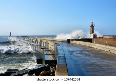 Strong waves hitting the breakwaters and the lighthouses