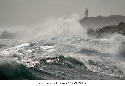 Strong waves  and lighthouse in background, La Garita, coast of Gran canaria