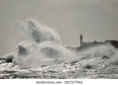 Strong waves and lighthouse in background, Taliarte, coast of Telde, Canary islands