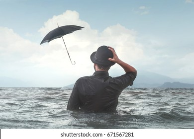 strong wind make umbrella fly surreal business bad luck concept