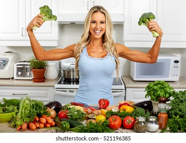 Strong woman with broccoli in the kitchen.