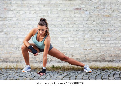 Strong woman exercise on street after jogging