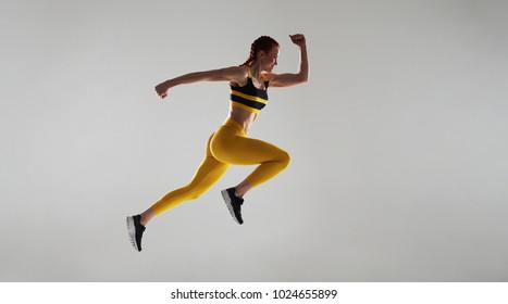 strong woman running fast