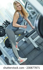 Strong woman in weightlifting in the gym, a series of