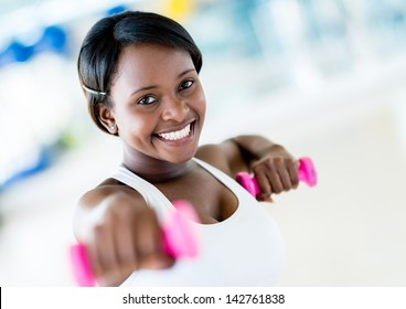 Strong woman weightlifting at the gym working out