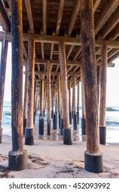Strong Wooden Pylons underneath of Ventura Pier, city of San Buena Ventura, Southern California