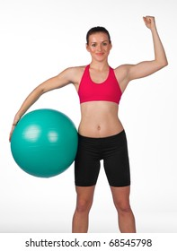 strong young woman in fitness clothes with pilates ball